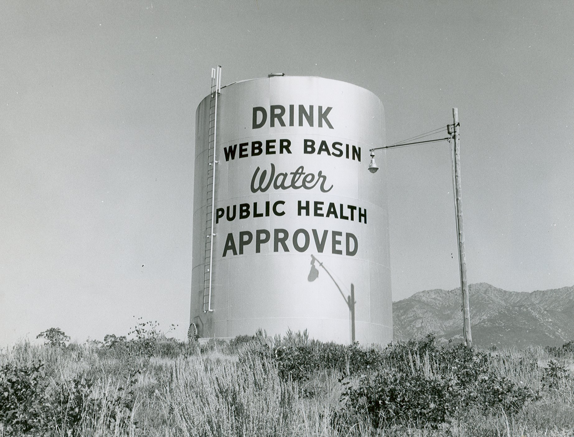 Large water tank with words saying Drink Weber Basin Water